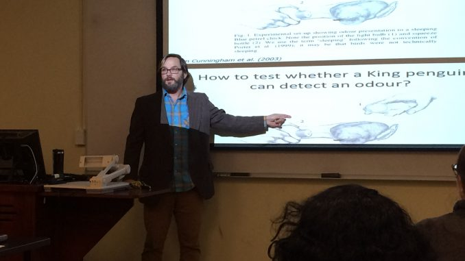 Dr. Cunningham presenting his work on penguin sense of smell