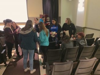 Students walked around Basil 135 to ask each other about financial experiences