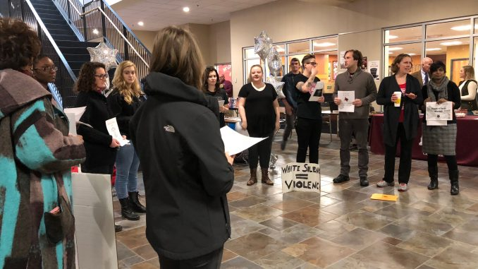 Students, faculty and staff gather in a silent protest